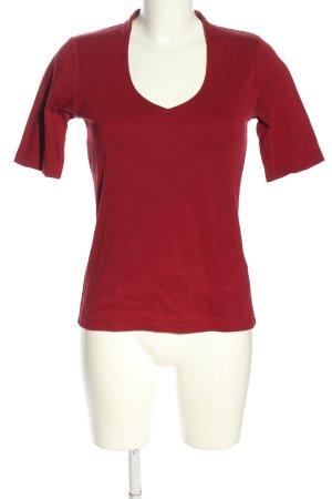 Manguun Camisa con cuello V rojo look casual