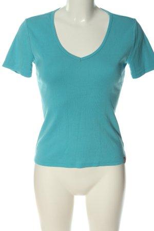 Manguun Camisa con cuello V azul look casual