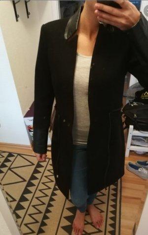 H&M Kurtka zimowa czarny Tkanina z mieszanych włókien