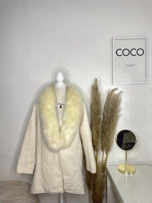Manteau polaire crème