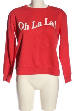 Mavi Suéter rojo-blanco letras impresas look casual