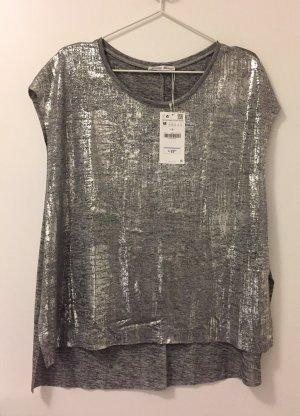 Metallic T-Shirt mit seitlichen Schlitzen