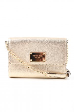 Michael Kors Minibolso color oro look casual