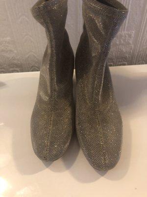 Michael Kors Slip-on laarzen goud