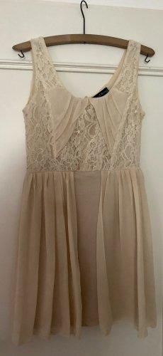 Mini vestido crema