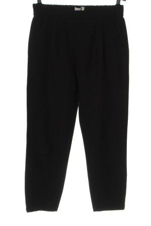 Minimum Pantalón tipo suéter negro look casual