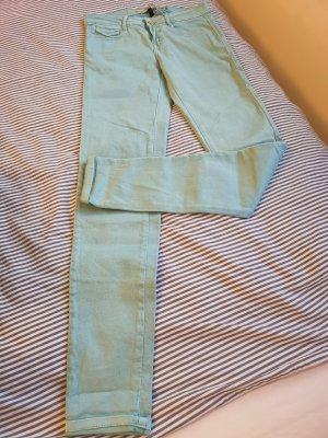 Mint-coloured ZARA slim jeans