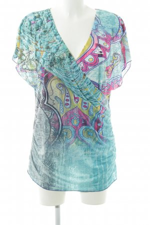 MIssy Camisa cruzada turquesa estampado gráfico look casual