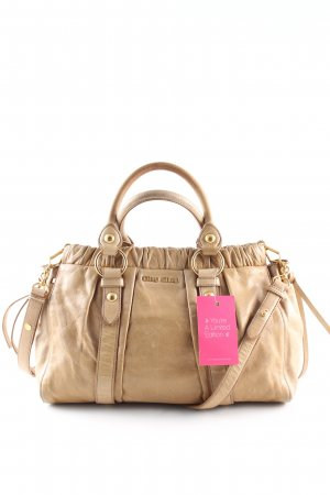 Miu Miu Bolso barrel crema look casual
