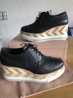 Miu Miu Neu  Sneaker in schwarz Platonabsatz