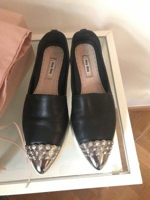Miu Miu sneakers with crystals