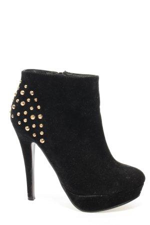 Modequeen Plateau-Stiefeletten schwarz-goldfarben extravaganter Stil