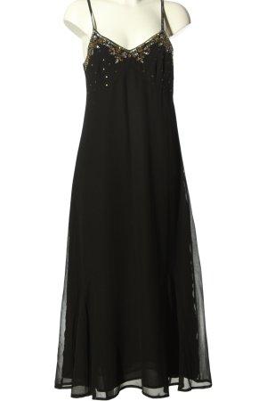 Modeszene Trägerkleid schwarz Elegant