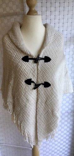 Poncho en tricot blanc cassé acrylique