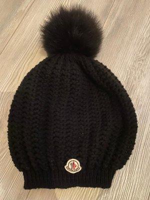 Moncler Wollmütze mit Fellbommel in schwarz