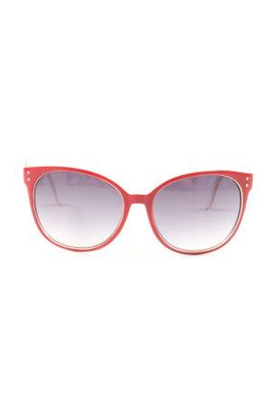 Moschino Gafas de sol ovaladas rojo look casual