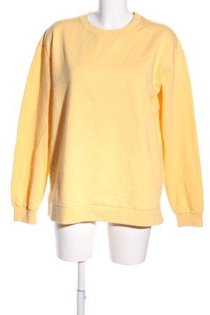 MOVES by Minimum Suéter amarillo pálido estampado temático look casual