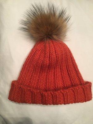 Chapeau en fourrure orange