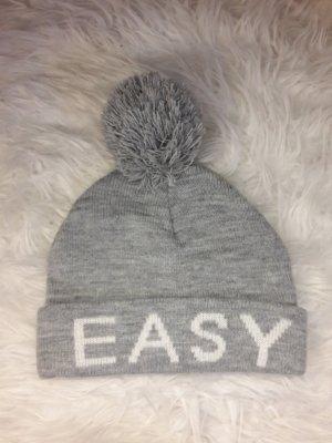New Yorker Cappello con pon pon bianco-grigio chiaro