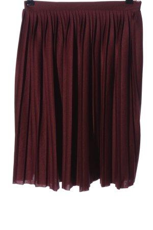 NA-KD Falda plisada rojo look casual