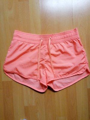 H&M Pantalón corto deportivo naranja neón