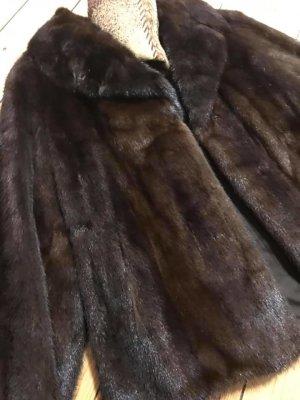 Pelliza marrón-negro-coñac Pelaje