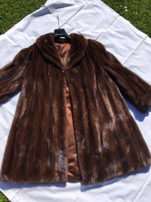 Manteau court brun fourrure