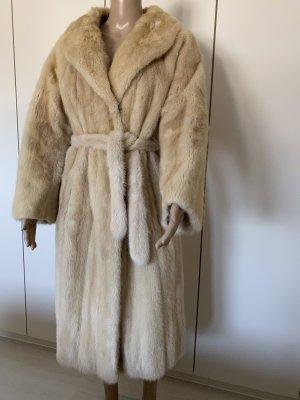 Manteau de fourrure crème
