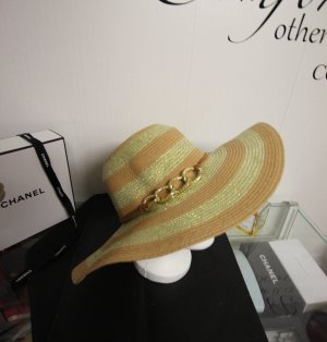 Sombrero de ala ancha color oro-marrón arena
