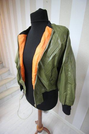 Blusón negro-naranja