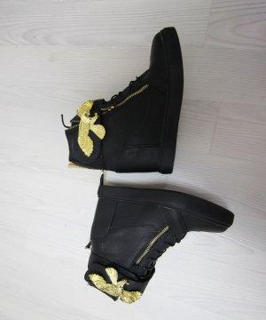 Sneaker con zeppa nero-oro