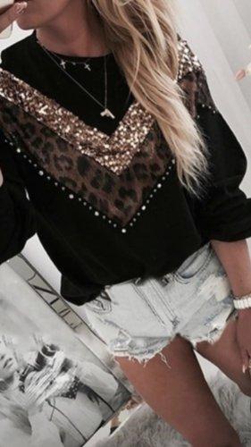Blusa tipo body negro-color oro