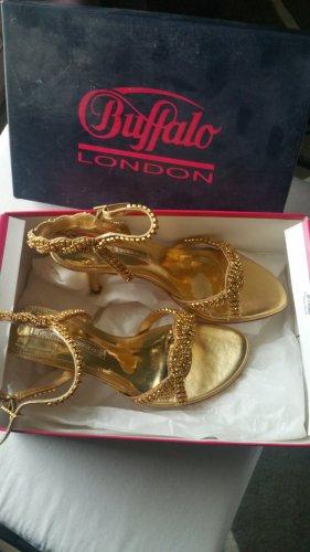 neue goldene Sandalen Buffalo