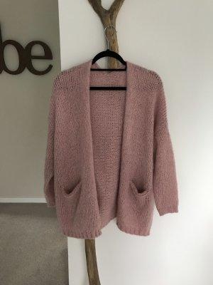 Veste tricotée en grosses mailles rose clair