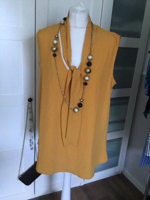 Comma Blusa con lazo naranja dorado