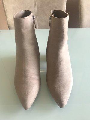 Neue Stiefeletten mit Glitzerabsatz