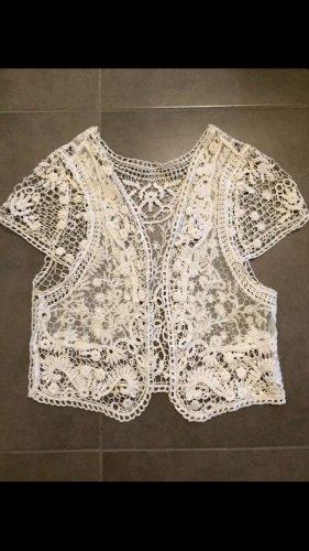 Szydełkowany sweter biały