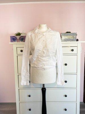 Neues weißes rückenfreies Hemd