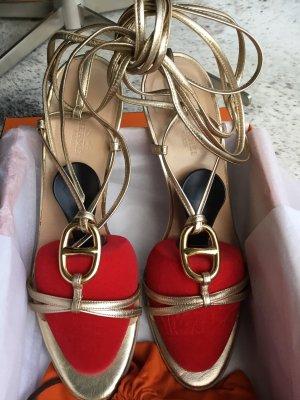 Hermès Sandały z rzemykami złoto Skóra