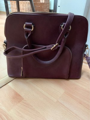 Neuwertige Handtasche in dunkelviolett