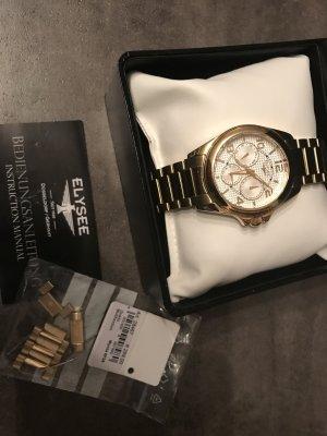 Neuwertige Uhr in Gold