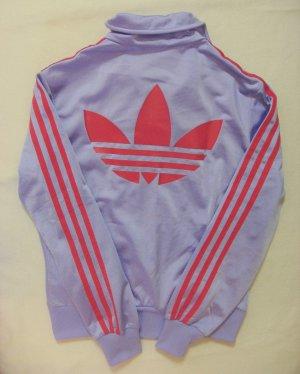 Neuwertige, wunderschöne ADIDAS Glanzjacke,Sportjacke,Trainingsjacke in seltener Farbkombi..lila mit rot, Größe Label DE40, kleiner:DE36/38