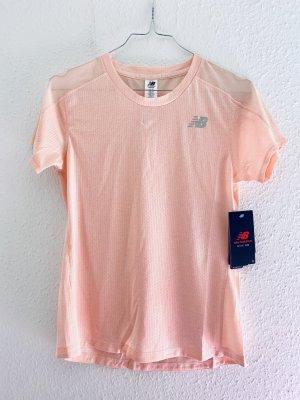New Balance Maglietta sport rosa pallido-rosa chiaro