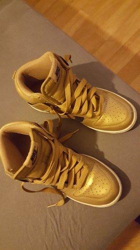 Nike Sneakers met veters zwart-goud