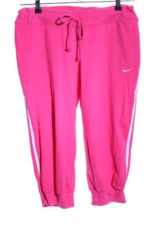 Nike Pantalón pirata rosa letras bordadas look casual