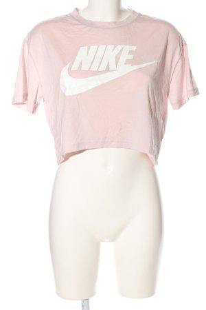 Nike Cropped Shirt pink-weiß Schriftzug gedruckt sportlicher Stil