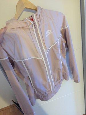 Nike Cortaviento rosa claro