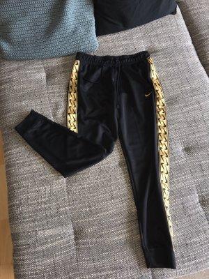 Nike Pantalone da ginnastica nero-oro