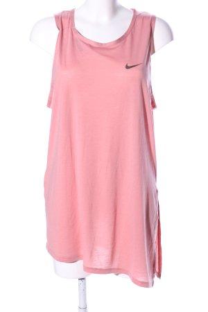 Nike Top largo rosa letras impresas look casual