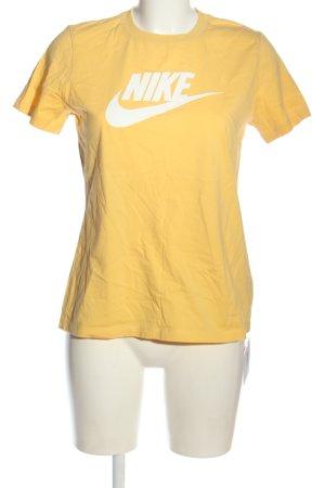 Nike Print-Shirt blassgelb-weiß Motivdruck Casual-Look